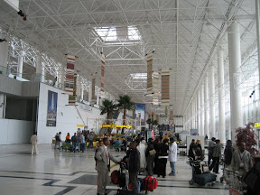 The arrival hall at Bole Int'l. Clean and uncluttered. Generic glass and steel tubing terminal.