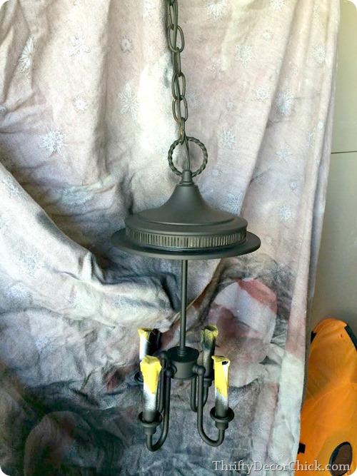 spray paiting a light fixture