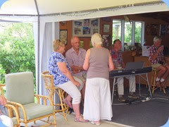 Attendees relaxing to the great music. The keyboard were set-up in the spacious garage come music room and which was extended by a large marquee to give us plenty of room and shelter from the lovely summer weather.