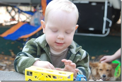 Mike playing with cars