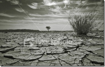 stock-photo-5790293-arid-dry-desert-landscape-black-and-white