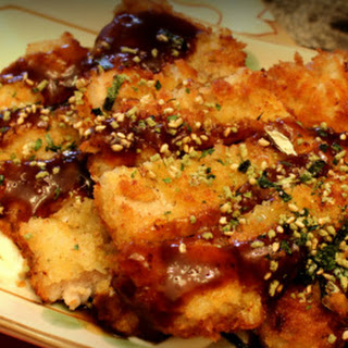 Japanese Dish involving pork chops fried with panko breading served with mayo and tonkatsu sauce