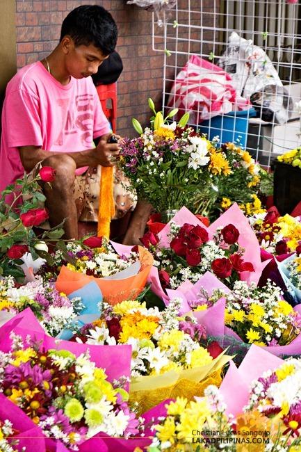 A Vendor Preparing a Bouquet at Dangwa Flower Market in Manila