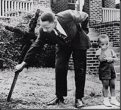 MLK Pulls Cross From Front Yard Lawn