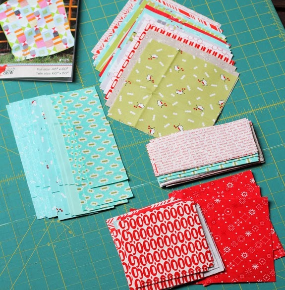 The start of a bizzy kid Christmas quilt