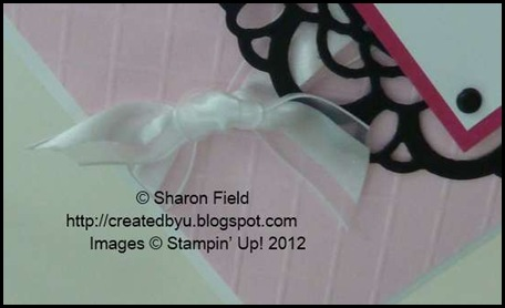 background texture created with diagonal score plate and organza ribbon knot aka bow