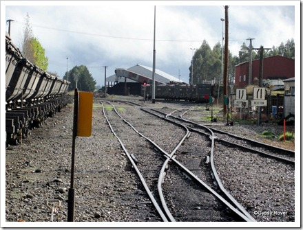 Reefton goods yard with Oceania Gold skips awaiting movement to Palmerston. Top loading containers on the right.