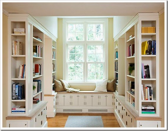 Traditional-home-library-with-cozy-reading-nook-White-Bookcase-Also-Showing-the-Window-Seat-Decorated-with-Cream-and-White-Pillows