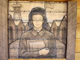 One of the wood block carvings at the Japanese Exclusion Memorial