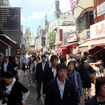 japanese school kids in a crowded shopping day on Takeshita Street in Harajuku in Harajuku, Tokyo, Japan