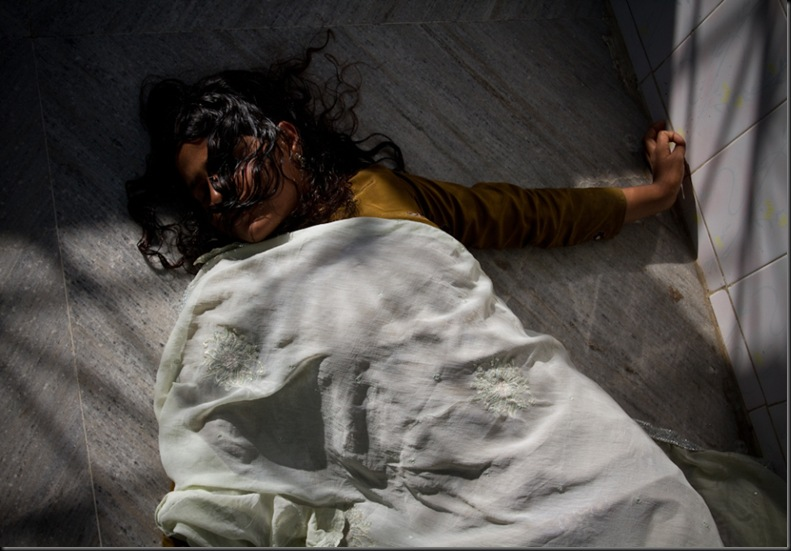 A Woman Exhausted After Her Exorcism-Dadi Amma ki Chakki- Photo © Tewfic El-Sawy-All Rights Reserved
