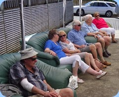 Some of the guests relaxing under the marquis and enjoying the music.