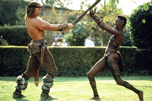 ARNOLD SCHWARZENEGGER & GRACE JONES<br />Film 'CONAN THE BARBARIAN' (1984)<br />29/06/1984<br />CTR58875<br />Allstar/Cinetext/UNIVERSAL<br />** WARNING** This photograph can only be reproduced by publications in conjuction with the promotion of the above film.