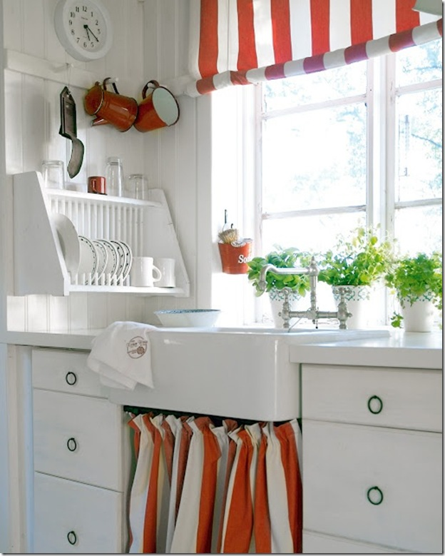 White kitchen with splash of red-love the stripe window swag and sink skirt -design addict mom