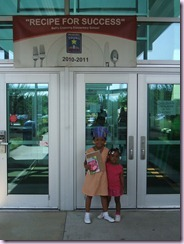 Ann and Nii in front of Bell's Crossing