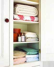 For a tidy linen closet, slip each sheet set into one of its pillowcases, and store the sets by size -- twin, full, and so on -- with colors, trim, or other defining details clearly visible.