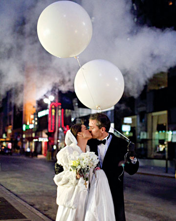 After their ceremony, this couple led guests to their Manhattan reception by way of a white balloon parade.