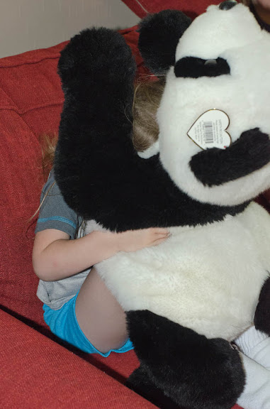 Hiding behind the panda