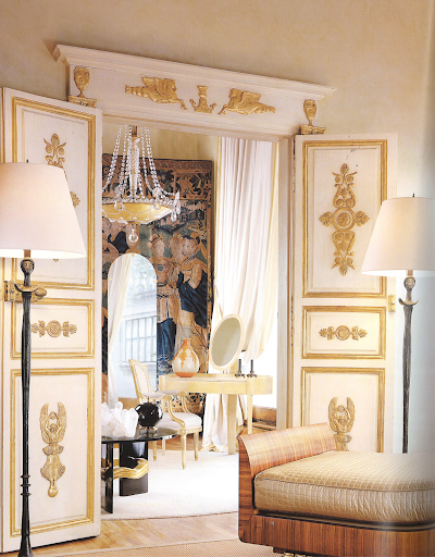 A pair of Classical Modern lamps by Jean-Michel Frank flanks the doorway into a collector's dressing room. A spectacular daybed pays homage to Empire precedents by Emile-Jacques Ruhlmann is in the foreground. (Regency Redux, Rizzoli)