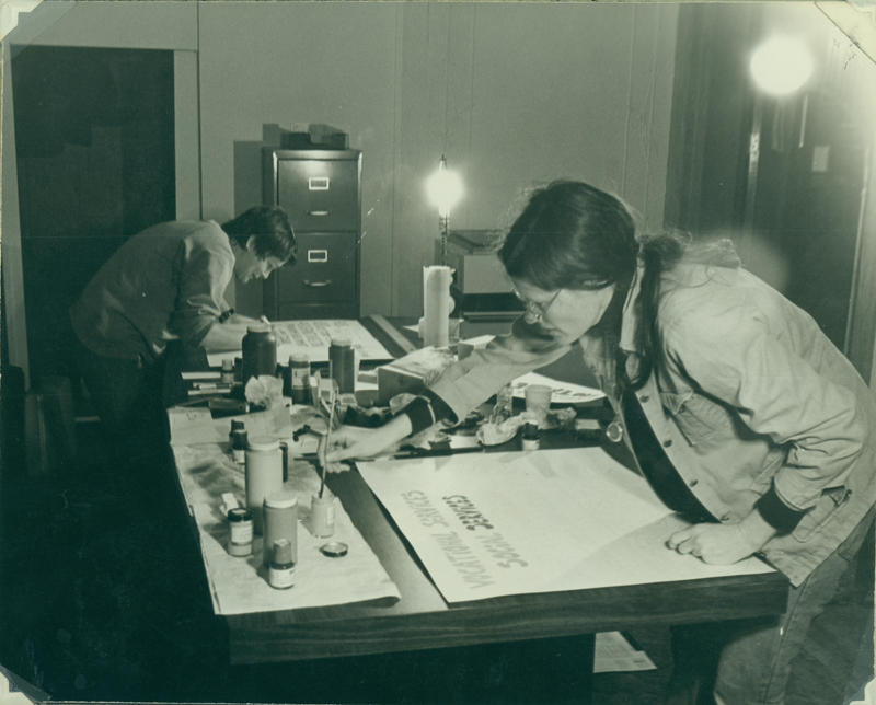 Denise and Carolyn Weathers at the Alcoholism Program for Women (APW) offices making signs for the open house. April 17, 1975.