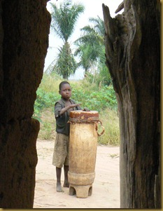 Nkonko church - boy on drum