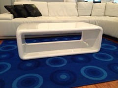 Coffee table in bright, glossy white fiberglass