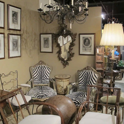 I like the use of zebra hide for the backing of those antique chairs.
