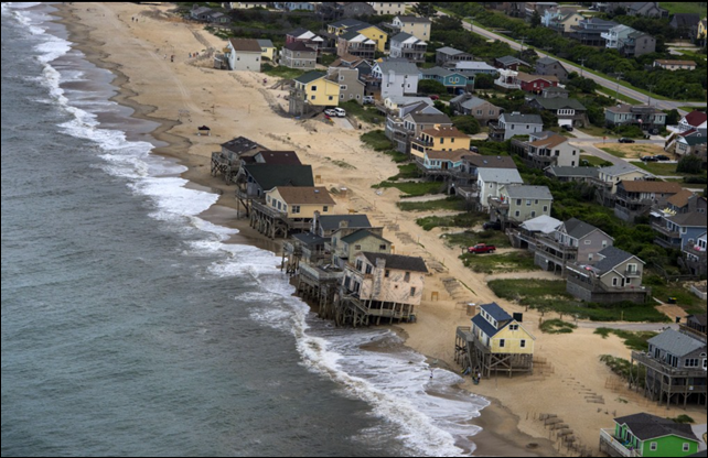Nags Head, N.C., seen in June 2014, is part of the state's Outer Banks region, which has become a flashpoint in the debate over global warming. In 2010, the science panel of the North Carolina Coastal Resources Commission concluded that sea levels along the coast could rise anywhere from 15 to 55 inches over the coming century. Photo: Nikki Kahn / The Washington Post