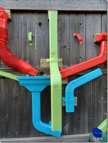 He Spray Painted Various Pieces Of Plastic Guttering And Mounting Brackets With Paint Then Mounted Them All To The Fence Like A Marble