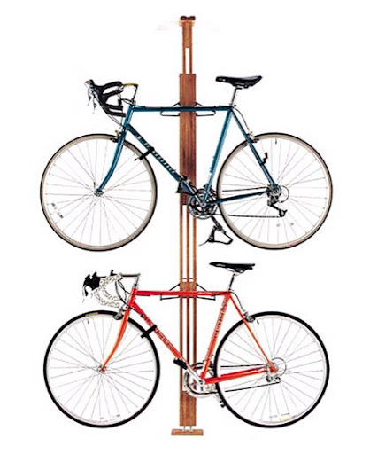 The wood adds warmth to this bike display. (Gear Up Floor to Ceiling Bike Rack, amazon.com)