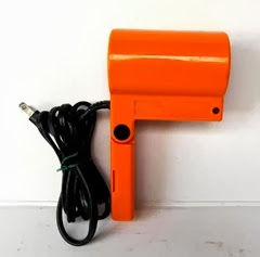 "Orange plastic Clairol MD-1 ""1 For The Road"" travel hair dryer."