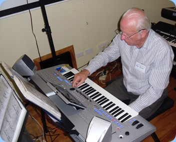 Rob Powell setting-up the Tyros 4 to play