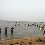 Swimmers getting ready and kayakers paddling out