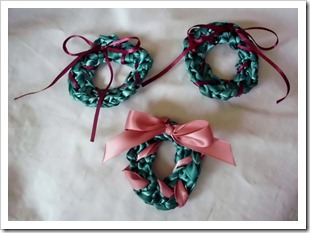 Crocheted ribbon Christmas wreaths.  Used for jewelry, hair accessories or decorations.