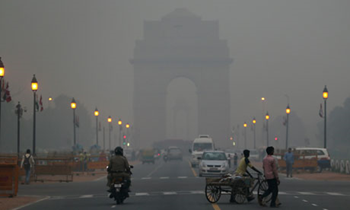 The India Gate monument in New Delhi, enveloped by a blanket of smog. An explosion of car use has made fast-growing Asian cities the epicentre of global air pollution and become, along with obesity, the world's fastest growing cause of death according to a major study of global diseases. Manish Swarup / AP