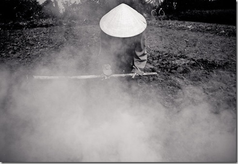 A farmer burns off crop residue to prepare for the upcoming harvest in Hanoi, Vietnam.