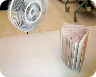 Fan drying a water-damaged book
