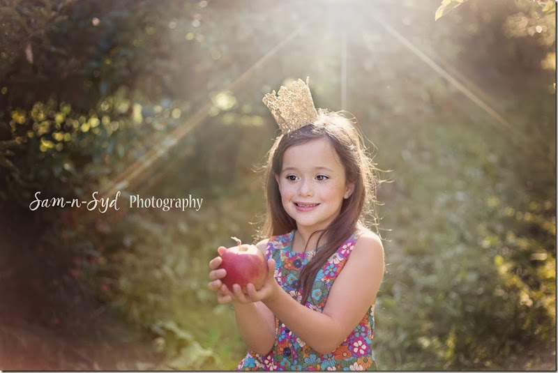 Isa holding apple watermark