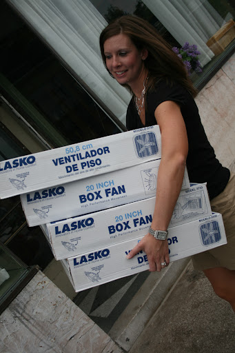 A Drury University Graduate student helps to unload the fans. (photo credit: James Mulvenon)