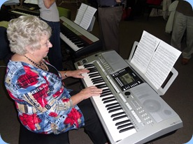 Barbara Powell giving Peter Brophy's Yamaha PSR-910 a work-out