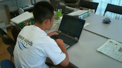 PWJ Staff using donated laptop