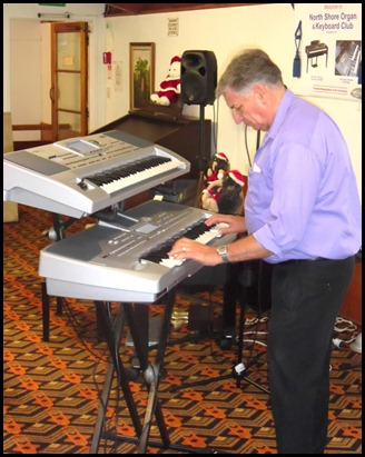 Our resident professional musician, John Bercich, brought two Korg keyboards to entertain us with. Loved the White Christmas arrangement.