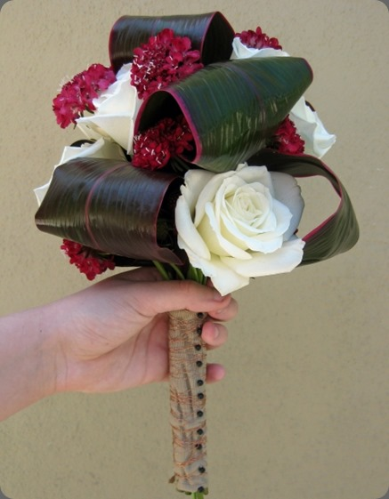 creative leaves rolled ti leaves with deep red scabiosa and white roses jacqueline ahne
