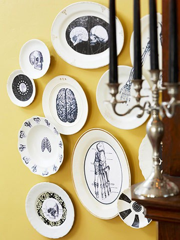 A cluster of macabre plates makes a statement on a tinted wall. (www.pinterest.com)