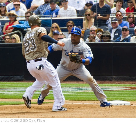 'Yonder Alonso tagged out by Juan Uribe' photo (c) 2012, SD Dirk - license: https://creativecommons.org/licenses/by/2.0/