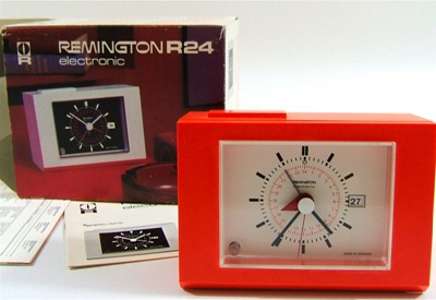 Remington R24 Sperry Rand battery operated orange plastic clock, with box