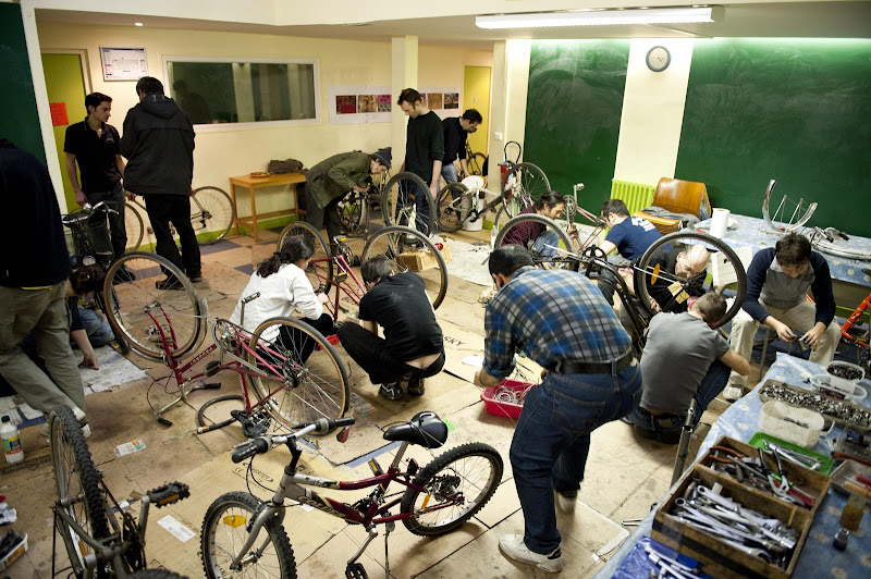 Volunteers and the under priveleged repairing bikes in the velocip aide workshop