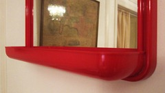 Mäkisen Kuvastin Oy mirror with red plastic frame and tray