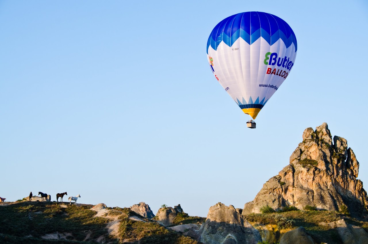 Hot air balloon with horses in Cappadocia