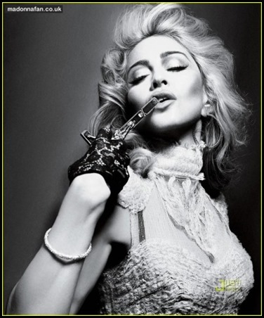 450_madonna-interview-magazine-crucifix-arms-492881768